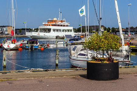 prow: FARJESTADEN, SWEDEN - AUGUST 7, 2015: Scenes from the marina in Farjestaden ferry city on the Oland island. City is named after the ferries that used to be the only connection to the mainland.