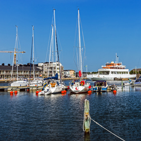 prow: FARJESTADEN, SWDEN - AUGUST 7, 2015: Scenes from the marina in Farjestaden ferry city on the Oland island. City is named after the ferries that used to be the only connection to the mainland.