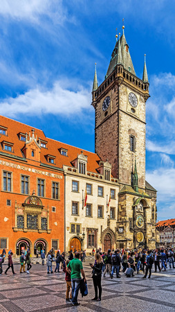 historic place: PRAGUE, CZECH REPUBLIC - OCTOBER 4, 2015: Scenes from the Old Town Square, a historic place with numerous landmarks, i.a. the medieval astronomical clock, Jan Hus memorial, the Baroque St. Nicholas Church and others.