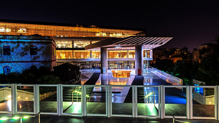 findings: ATHENS, GREECE - NOVEMBER 6, 2015: Night view of The Acropolis Museum,  an archaeological institution focused on the findings of the archaeological site of the Acropolis of Athens.