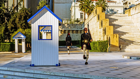 tomb of the unknown soldier: ATHENS, GREECE - NOVEMBER 6, 2015: Changing of the guards at the Greek Tomb of the Unknown Soldier. The guard is held by The Evezones, a ceremonial traditionally uniformed unit of The Presidential Guard.