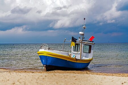 Fishing boat on the beach in Sopot, Poland.