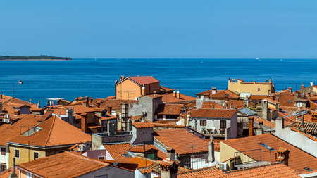 Aerial view of Piran, town on the Adriatic Sea, one of Slovenias major tourist attractions, with medieval architecture, narrow streets and compact houses.