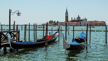 Gondolas in Venice, Italy on the background of the San Giorgio Maggiore Church