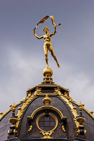 Statue on the ancient guildhall in the Grand Place and main attraction of the city, full of tourists 24 hours a day.