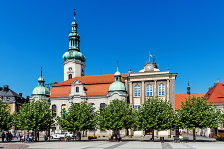 PSZCZYNA, POLAND – SEPTEMBER 9, 2017: Lutheran church and town hall in the main square. City was founded 1303 and Lutheranism was introduced to Pszczyna in 1568 by Duke Karol Promnitz.