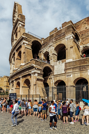 ROME – AUGUST 10, 2017: Turists waiting for entry to the Colosseum, the largest amphitheatre ever built, built in the years 72-80 under the Flavian dynasty emperors Vespasian and his successor Titus.