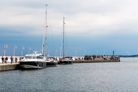 SOPOT, POLAND – JULY 8, 2017: Scenes from the Sopot Marina. Place can accommodate 103 yachts in total, including 40 berths for larger boats with a length of 10-14 m and 63 for boats up to 10 m. Banco de Imagens - 90482260