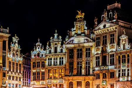 BRUSSELS - JUNE 15, 2017: Ancient tenements in the Grand Place, place is UNESCO World Heritage Site and main attraction of the city, full of tourists 24 hours a day.