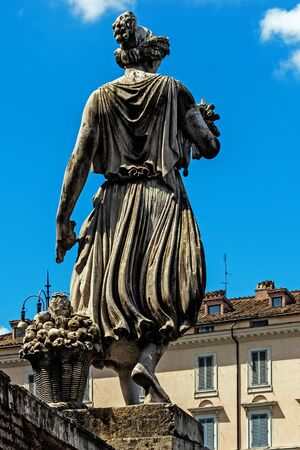 ROME – AUGUST 8, 2017: Sculpture of a woman with fruits and vegetables in the Piazza del Popolo, a large urban square. The name of the square in Italian literally means