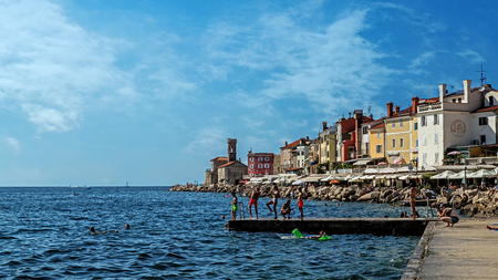 PIRAN, SLOVENIA – JULY 31, 2017: Cityscape of Piran, town on the Adriatic Sea, one of Slovenias major tourist attractions, with medieval architecture, narrow streets and compact houses.