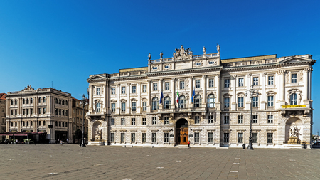 TRIESTE, ITALY – AUGUST 03, 2017: View of Piazza Unita dItalia (Unity of Italy Square), the main square in town located at the foot of the hill with the castle of San Giusto facing the Adriatic Sea.