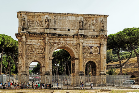 ROME – AUGUST 10, 2017: The Arch of Constantine nearby the Colosseum, erected by the Roman Senate to commemorate Constantine Is victory over Maxentius at the Battle of Milvian Bridge in 312. Editorial
