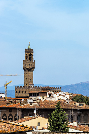 Distant view of the Palazzo Vecchio, ancient town hall in Florence, Italy.