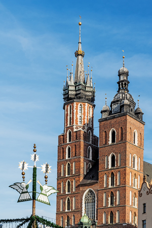 KRAKOW, POLAND - NOVEMBER 25, 2017: Towers of St.Mary Church in the Main Square in Krakow, Poland, brick Gothic church built in the early 13th century is the main landmark of the city.