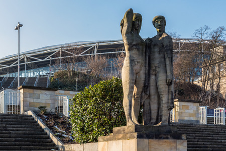 LEIPZIG, GERMANY - FEBRUARY 7, 2018: Socialist realism sculptures that survived the communism era at the entrance to Red Bull Arena, the largest football stadium in the former East Germany.