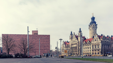 LEIPZIG, GERMANY - FEBRUARY 8, 2018: View of Wilhelm Leuschner Square with The Propsteikirche St. Trinitatis, modern Catholic church and New Town Hall, the seat of the Leipzig suthorities since 1905.