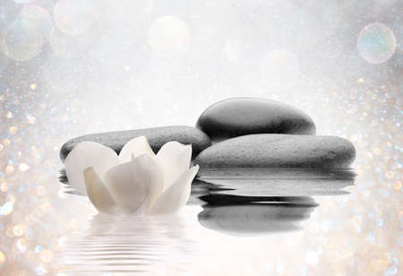 black stones: spa flowers with water and stones