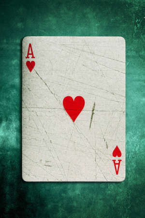 Grunge Ace of hearts Playing on a textured green felt background