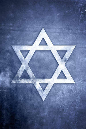 White Star of David on blue textured grunge background photo