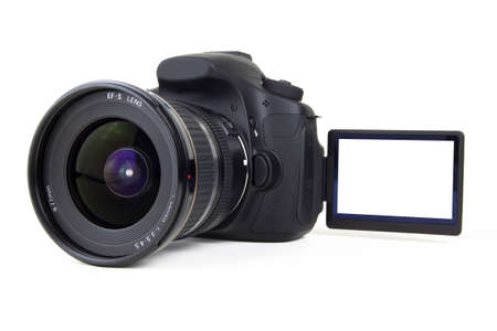 A front view photo of a video DSLR camera with a blank articulating screen on a white background. Add your Own Photo. Фото со стока