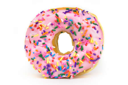 sprinkle: A pink frosted donut with colorful sprinkles isolated on a white background Stock Photo