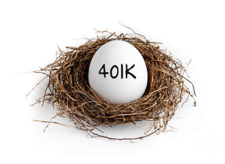 nest egg: A white egg in a nest on a white background with the word 401K on the egg