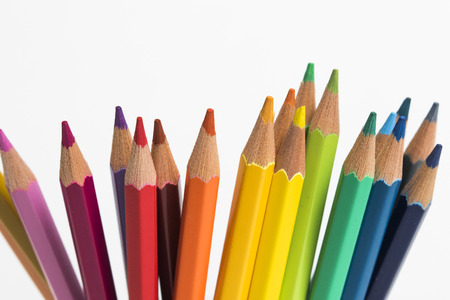 sharpen: A group of rainbow colored pencils on an isolated background