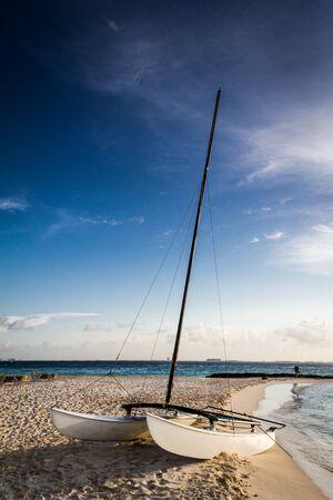 A single sports sailboat lying at the beach at the Caribean near Cancun Mexico Imagens