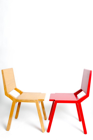 two modern chairs facing each other in a white isolated background