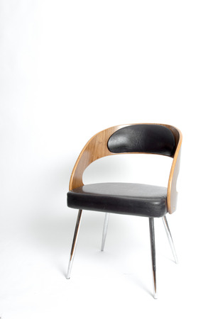 Modern style chair in a white isolated background Imagens