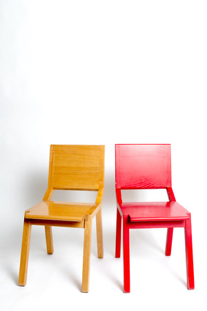 two modern chairs next to the other in a white isolated background