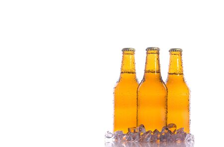 beers: Three isolated fresh beers with ice Stock Photo