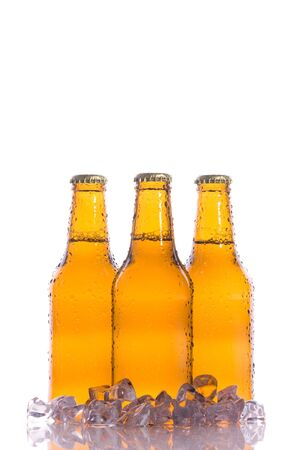 beerhouse: Three isolated fresh beers with ice Stock Photo