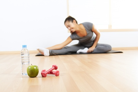 Elements of a healthy lifestyle with beautiful girl doing sport in the background Stock Photo - 10946994