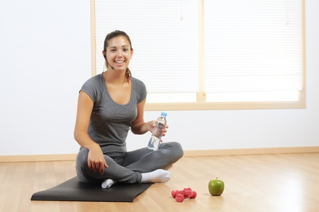 Beautiful Hispanic girl resting from sport exercises Stock Photo - 10949627