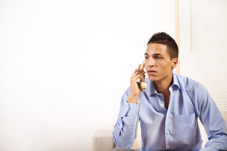 Portrait of a young businessman talking on the phone. photo