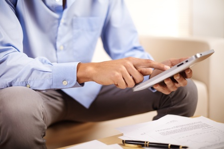 Portrait of a young businessman using a Tablet PC. photo