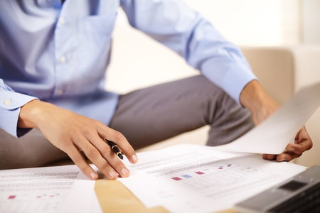 Portrait of a young businessman working with documents. photo