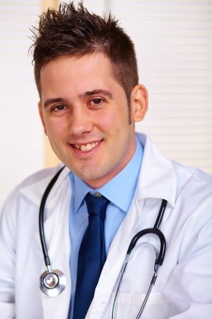 Portrait of a young doctor at work. photo