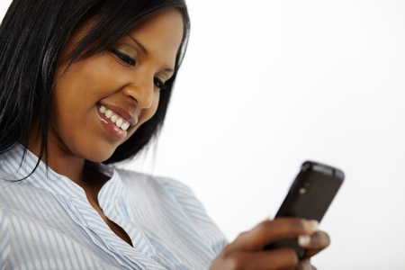 Close up portrait of a charming beautiful young woman reading a text message on mobile phone photo