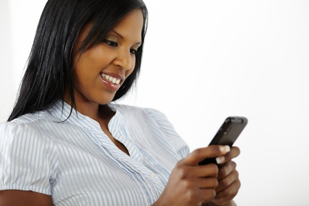 Close up portrait of a attractive young woman reading on a mobile phone Stock Photo - 12866926
