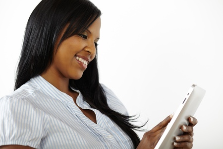 Close up portrait of a beautiful young woman using a tablet PC
