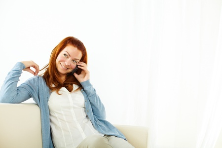 Portrait of a smiling young woman talking at cellphone Stock Photo - 13314106