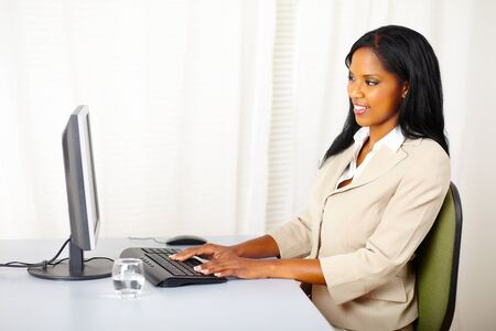 Portrait of a attractive businesswoman using a computer photo