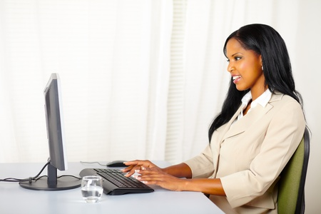 african american woman business: Portrait of a friendly businesswoman working on computer Stock Photo
