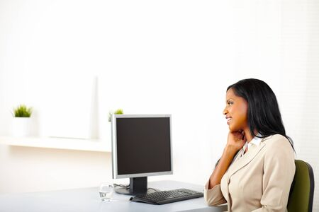 Portrait of a cute business lady looking to the monitor screen with copy space. photo