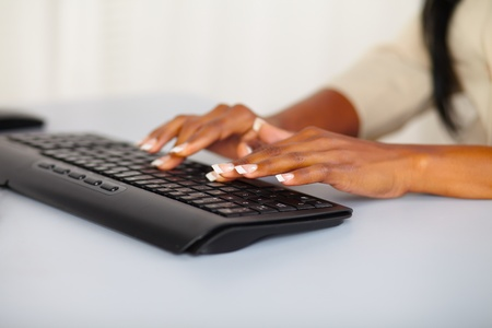 Close up portrait of the hands of a pretty woman working on computer photo