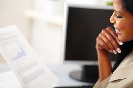 Portrait of a young business woman reading documents Stock Photo
