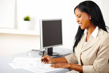 Portrait of a friendly female executive on work Stock Photo
